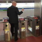SEPTA General Manager Jeffrey Kneuppel uses a SEPTA Key card at a turnstile in the concourse under Dilworth Park.