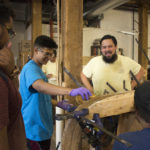 Jesus Castro works with kids at the Philadelphia Wooden Boat Factory.