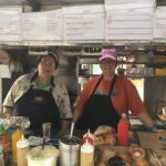 Eleni Grohimos, with daughter Stella, has operated the food cart at Broad and Sansom for about 35 years.