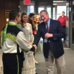 Mayor Jim Kenney shakes the hands of St. Joe's Prep theater students after performing with them on stage