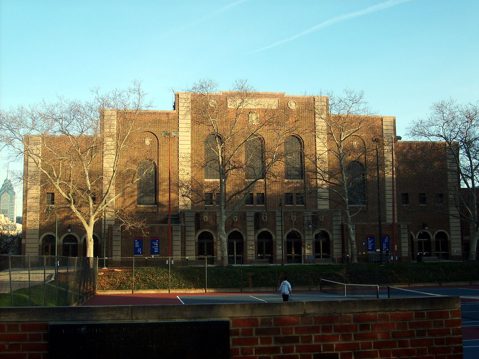 The sun sets over the Palestra