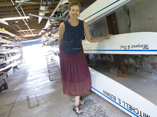 Margaret Meigs, vice commodore of the Schuykill Navy and formerly its second-ever female commodore, poses beside a boat named after her and her husband.