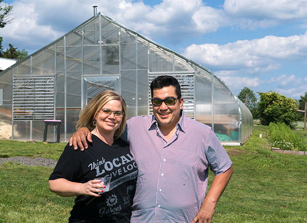Jose Garces at Luna Farm next to catering sales director Beth Koenig