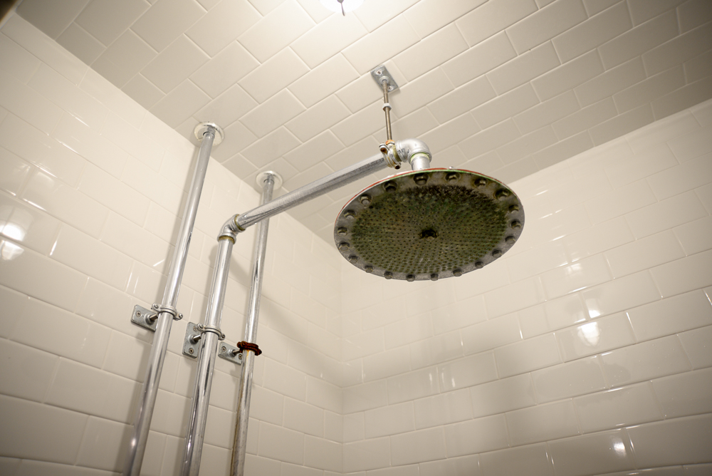 The original shower heads in the men's locker room.