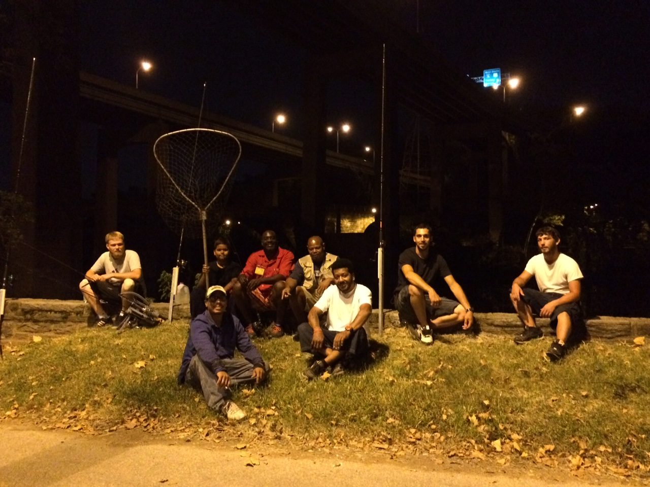 Summertime means nighttime fishing in the Schuylkill River where people catch catfish weighing as much as 40 pounds. From left: Eric Pell, Marcus Fero III, Marcus Fero, Troy Rimes, Darryl Booker, Michael White, Dave Stulpin and Anthony Schuler.