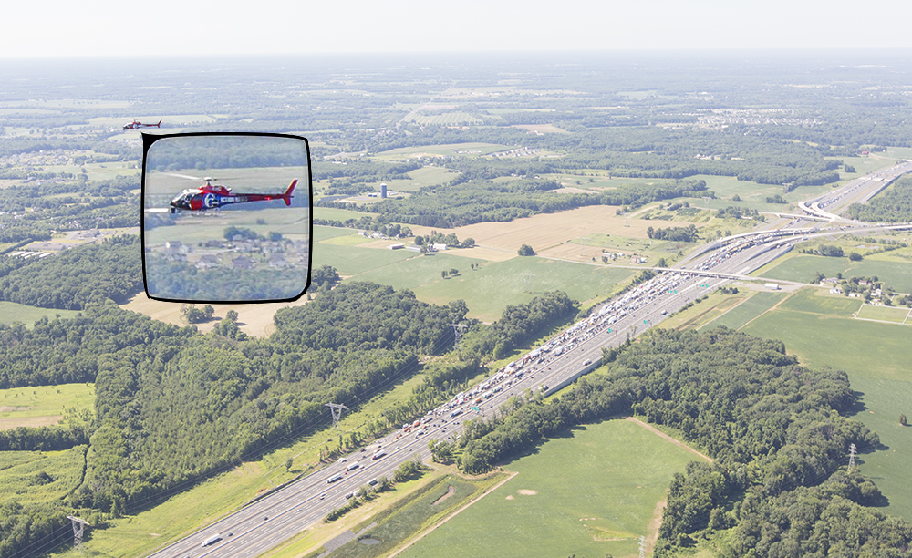 6abc's chopper as viewed from Skyforce 10 over an accident scene on the New Jersey Turnpike. News choppers can share the same airspace over a story by staggering their heights.