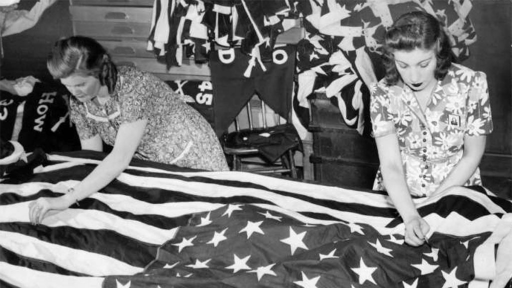 Grace Stanton stitches a large flag for the 1951 Fourth of July celebration in Fairmount Park