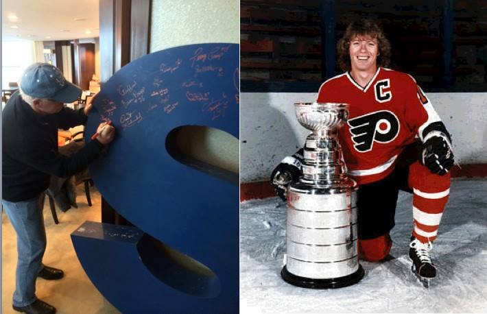 Bobby Clarke signing the 'S'.