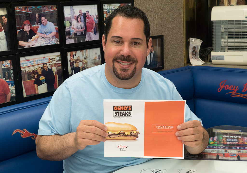 Geno Vento holds plans for the Xfinity Live cheesesteak counter