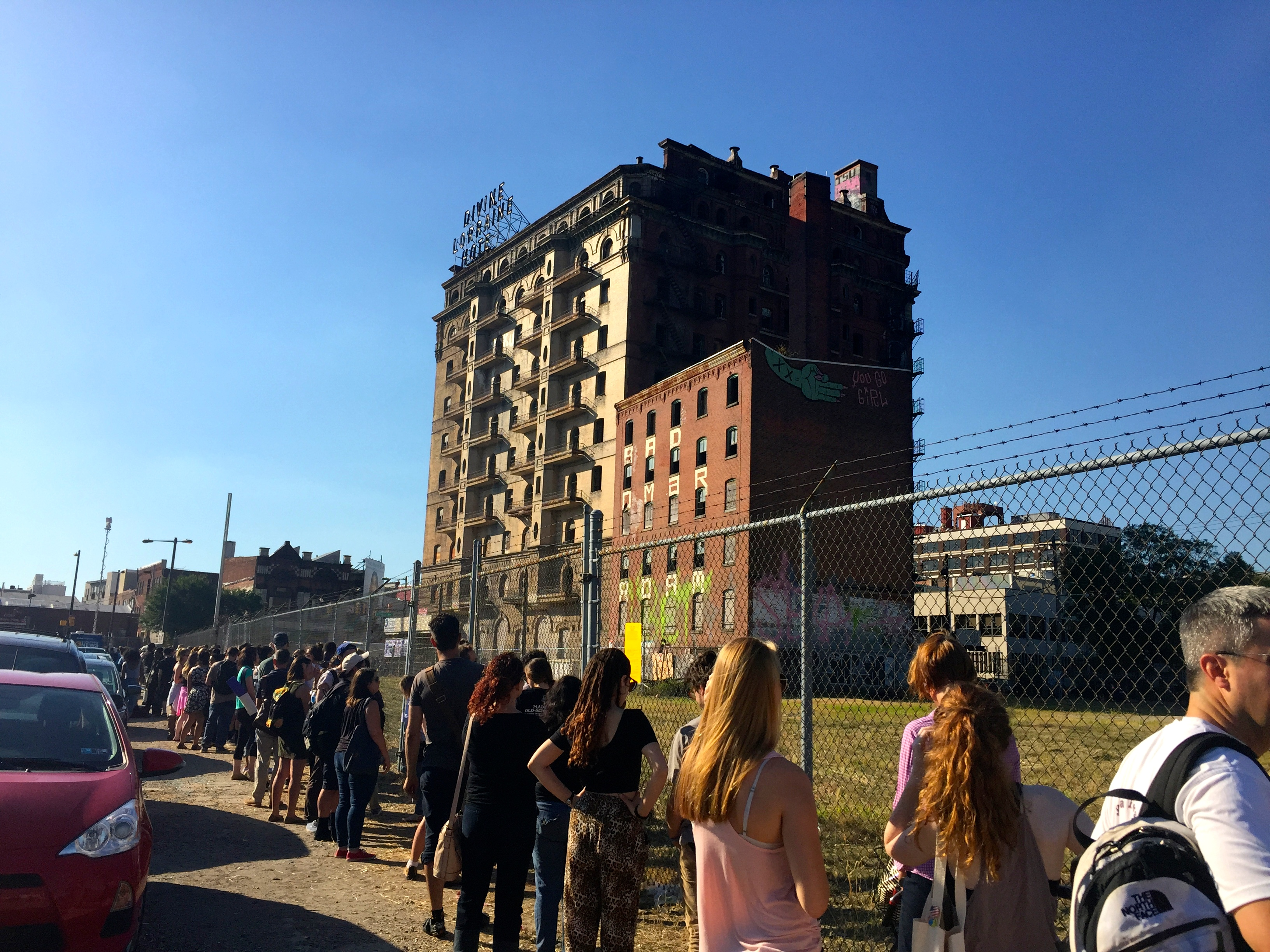 People wait in line to see the inside of the Divine Lorraine Hotel on the day of groundbreaking.