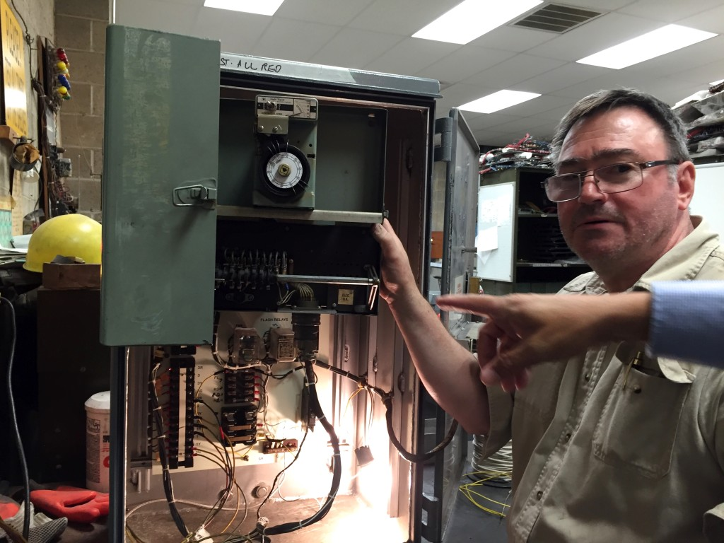 A technician shows us the machine that controls traffic signals.