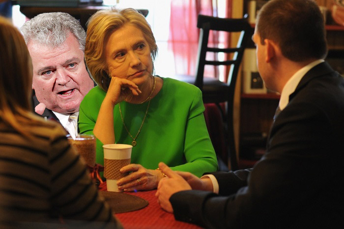 Bob Brady sneaking up on Hillary Clinton's coffee cup.