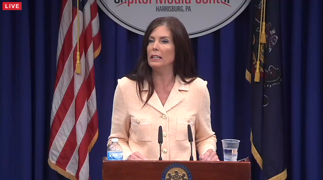 Kathleen Kane delivers a press conference in August after charges are filed against her.