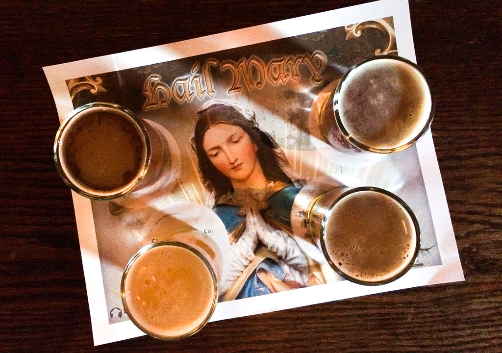 Four of the Pope in Philly beers at the P.O.P.E. bar