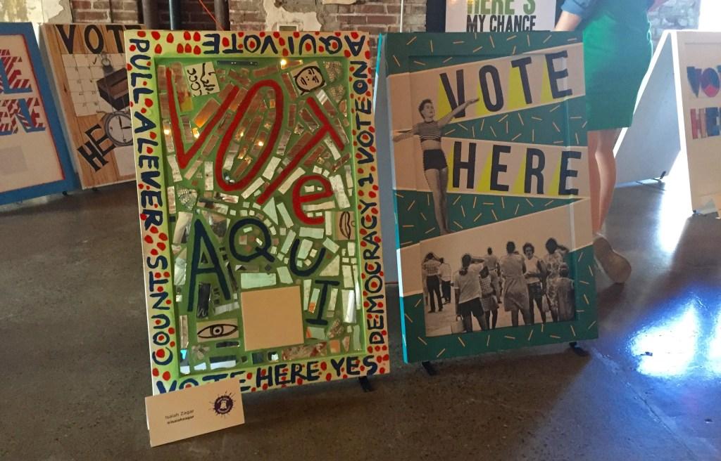 Voting sign created by mosaic artist Isaiah Zagar (left).