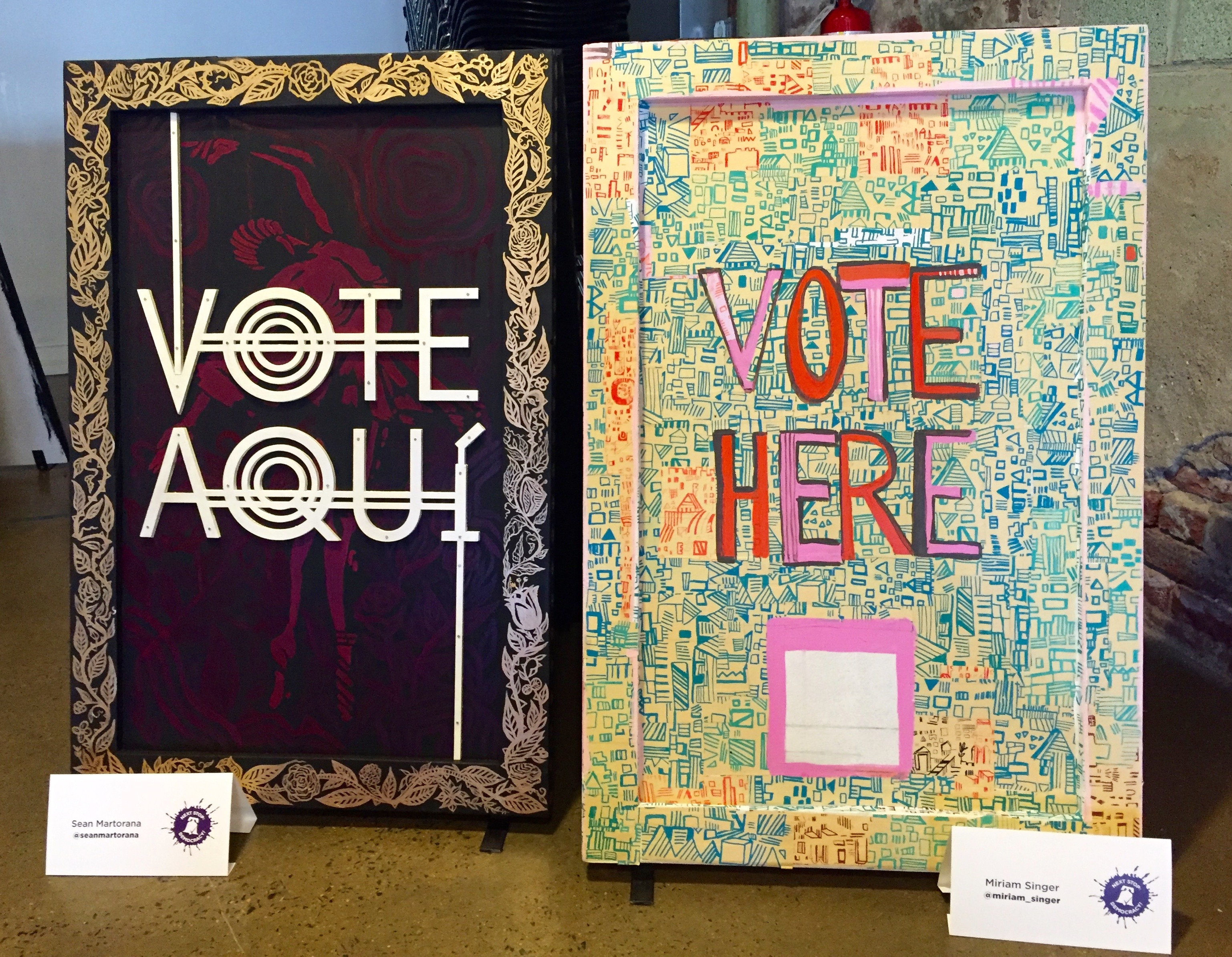 """Vote Here"" signs created by Sean Martorana (left) and Miriam Singer as part of the Next Stop Democracy project."