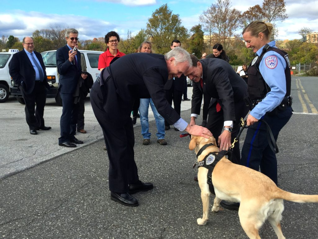 Sen. Ron Johnson and Sen. Pat Toomey pet a dog at the PennVet Working Dog Center.