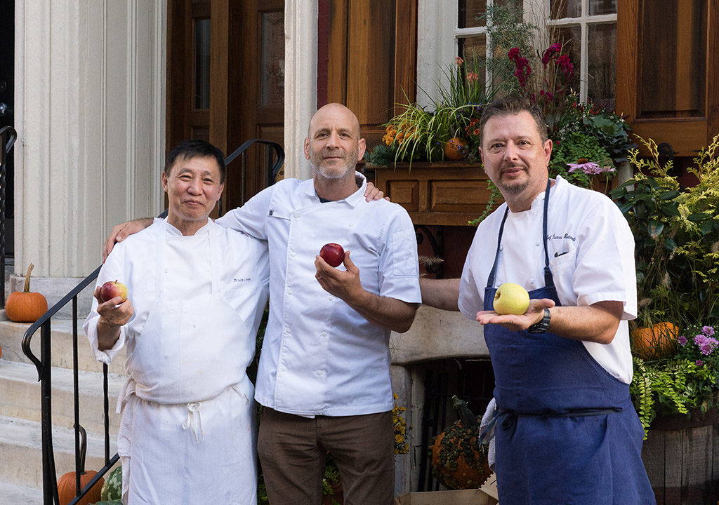 Bruce Lim (left) and Francesco Martorella (right) stand with Marc Vetri at a recent Ciboulette reunion dinner