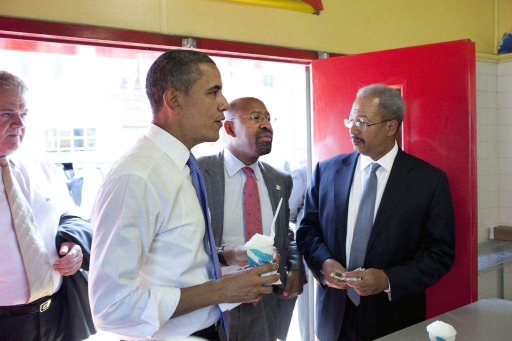 President Barack Obama, with Rep. Robert Brady, left, Philadelphia Mayor Michael Nutter, center, and  Rep. Chaka Fattah, right, place their order during a stop at John's Water Ice 2011.