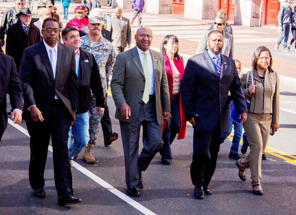 Council President Darrell Clarke (5th District), Councilman Bobby Henon (6th District), District Attorney Seth Williams, Mayor Michael Nutter, City Councilwoman-elect Helen Gym (At Large) Councilman Curtis Jones Jr. (4th District) and State Rep Donna Bullock march in the Veterans Day parade.