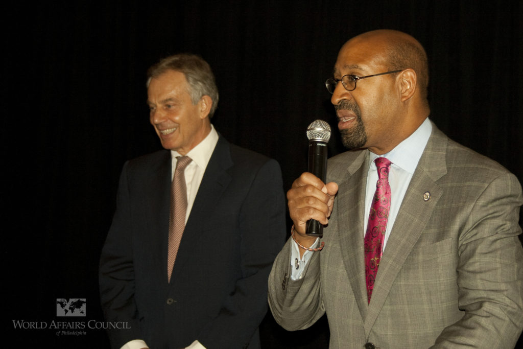 Mayor Michael Nutter introduces former Prime Minister of the United Kingdom Tony Blair at a 2012 event.