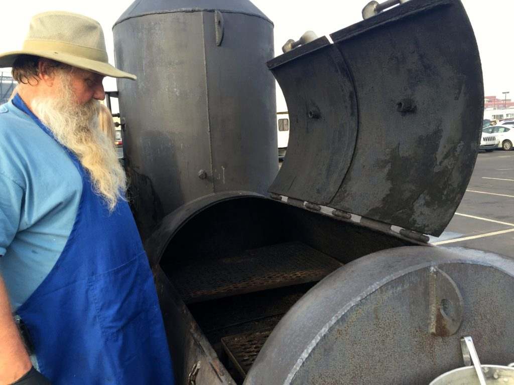 Ray Ratay with the cooker portion of his meat smoking contraption.
