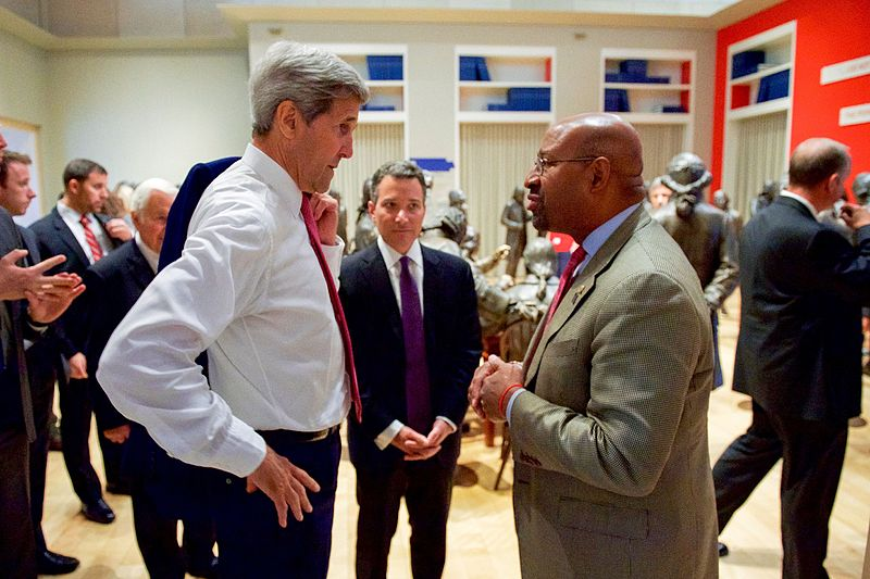 U.S. Secretary of State John Kerry speaks with Philadelphia Mayor Michael Nutter on September 2, 2015, after delivering a speech about the Iranian nuclear deal at the National Constitution Center.