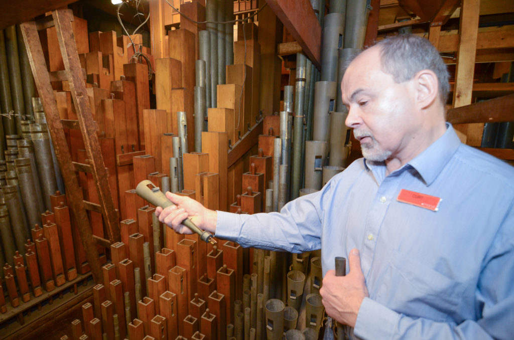 L. Curt Mangel III shows us a special organ pipe equipped with a reed.