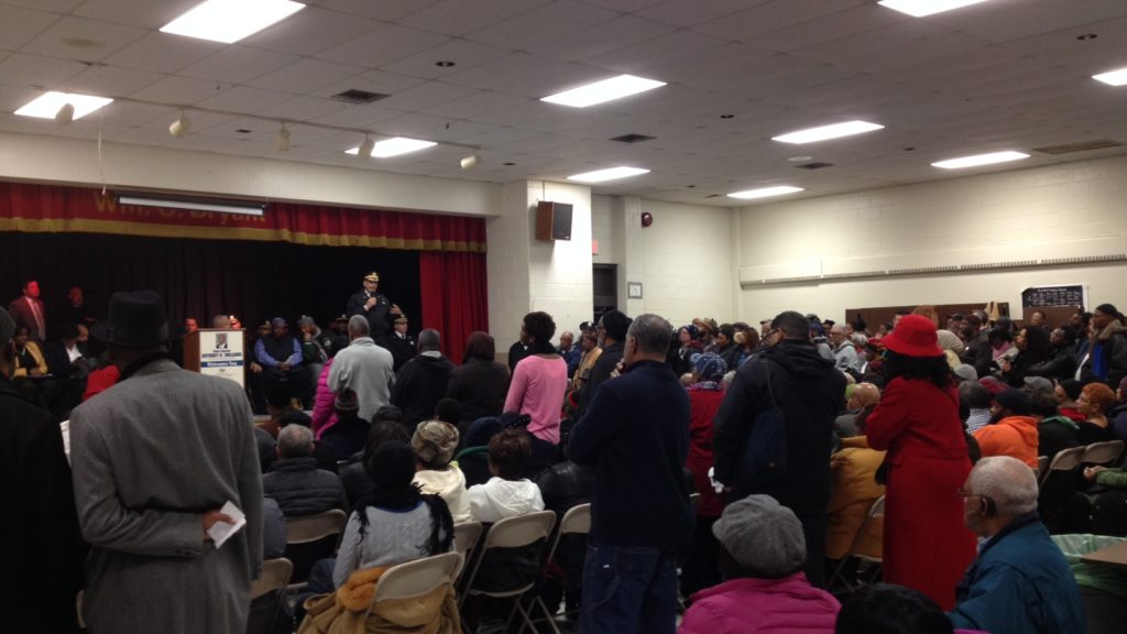 A standing room crowd listens to deputy police commissioner Myron Patterson.