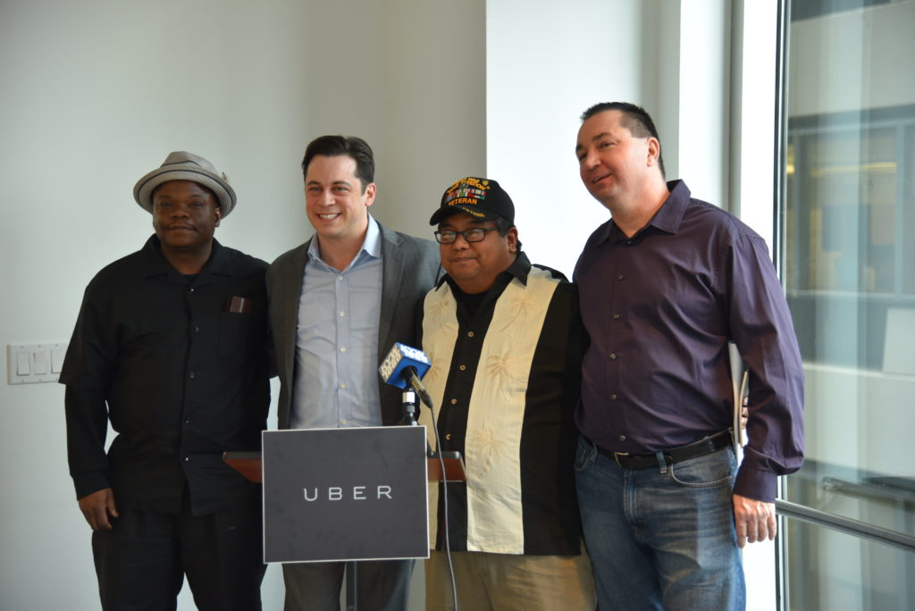 Uber Pennsylvania GM Jon Feldman, in the suit, denounced the PPA and called for the state legislature to extend its acceptance of Uber to Philadelphia. He was joined by UberX drivers, including, from left, Timothy Judelshon and Raymond Reyes.
