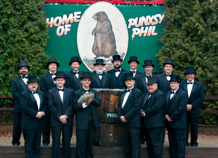 Members of Phil's Inner Circle standing at Gobbler's Knob.