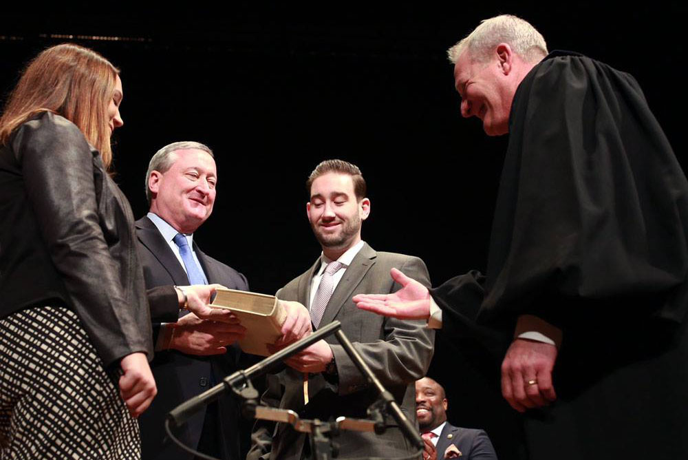 Mayor Jim Kenney is sworn in as mayor by Kevin Dougherty, a state Supreme Court judge and John Dougherty's brother.