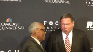 "David L. Cohen greets 1948 Olympic medalist Herb Douglas before the Philadelphia premiere of ""Race."""