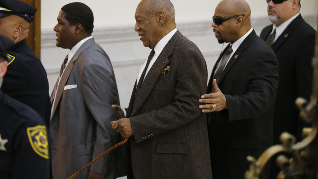 Bill Cosby and his team enter the courtroom.