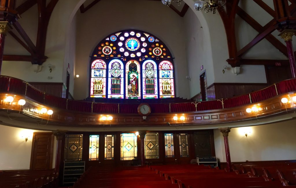 The original stained glass windows inside the Mother Bethel AME church sanctuary.