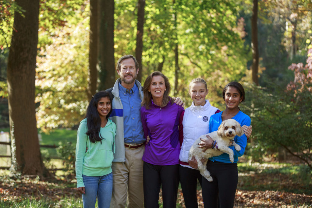 Katie McGinty (center) with her husband and three daughers.