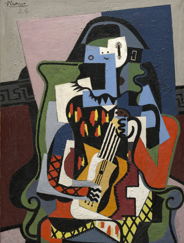 Harlequin Musician (1924), borrowed from the National Gallery of Art.