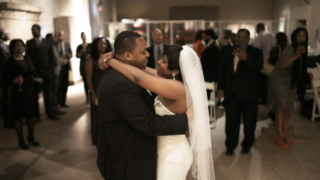 Ray and Aja Gordon on their wedding day at Penn Museum.