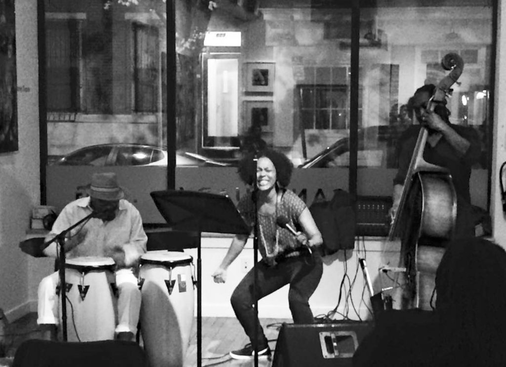 Wisher, who also sings her poetry in a jazz band, in performance. Yolanda Wisher & The Quick Fixx counts Karen Smith on percussion, and Wisher's husband, Mark Palacio, on bass.