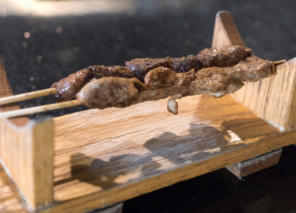 Chicken and beef skewers that go for $1 and $1.50 each