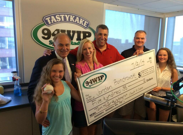 Angelo Cataldi (in the red) stands in the WIP studios with Rhea Hughes and Ed Rendell.