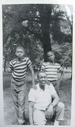 Moore as a boy with his uncle and twin brother.