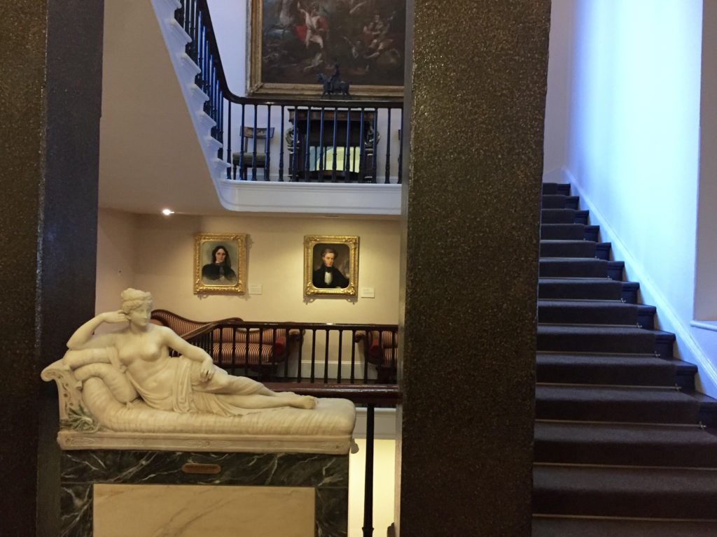 The beginning of the winding staircase inside The Athenaeum.