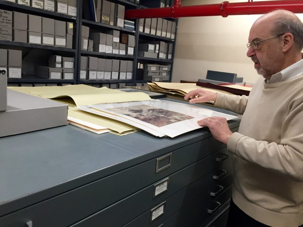 Peter Conn looks at prints in the basement of The Athenaeum of Philadelphia.
