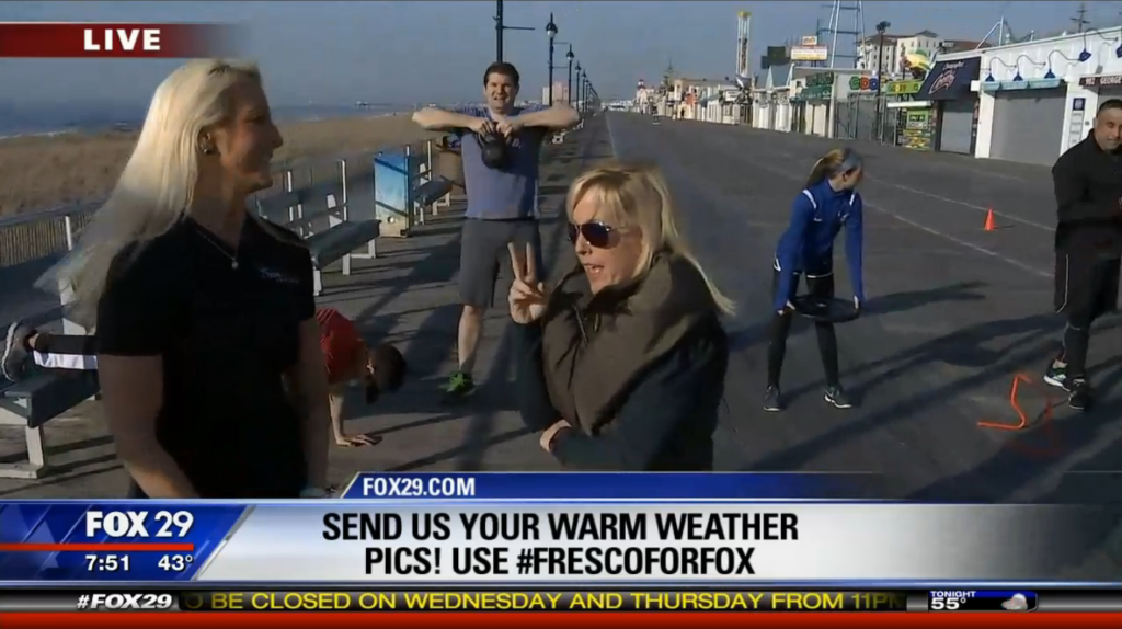 """Fox 29 reporter Jenn Frederick stands on the Ocean City, N.J. boardwalk and during a segment about getting rid of """"butts and guts"""" for the summer"""""""