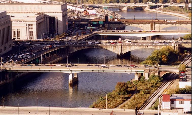 The crime-ridden, wooded area next to the Schuylkill before the trail was extended into Center City.