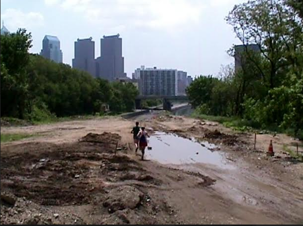 In 2003, during the middle of construction, runners were already trying to sneak on the trail.