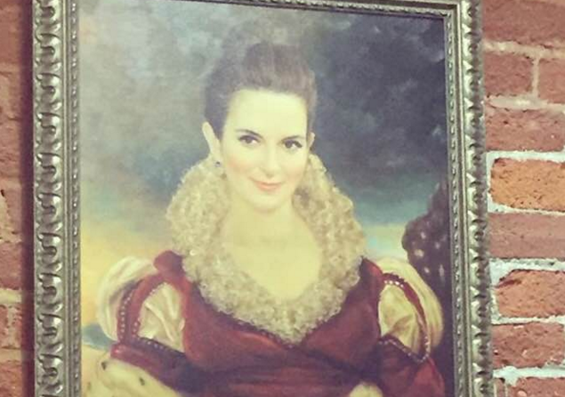 The oil painting of Tina Fey that sits outside one of Delphic's conference rooms.