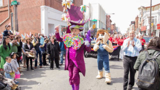 Henri David leads the Easter Promenade down South Street