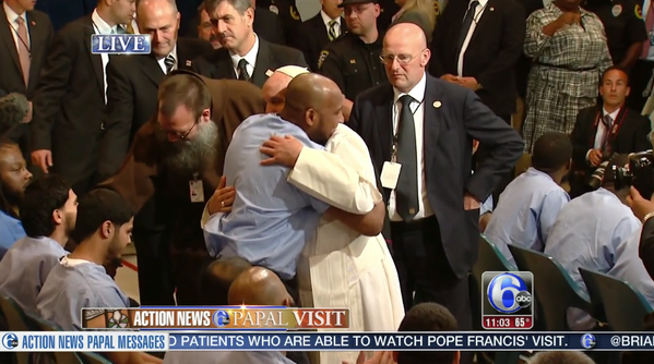 Pope Francis hugs an inmate at the Curran-Fromhold Correctional Facility during his visit to Philadelphia.
